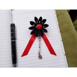 Kvet na kočík (čierny) lienka červená